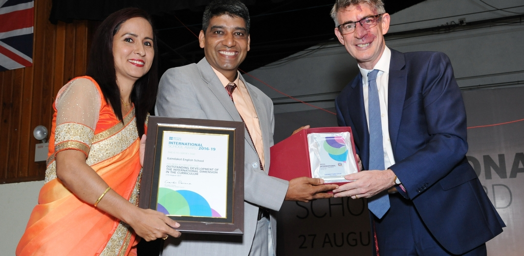 001 Principal & ISA coordinator receiving award from the British Ambassador to Nepal, Richard Morris